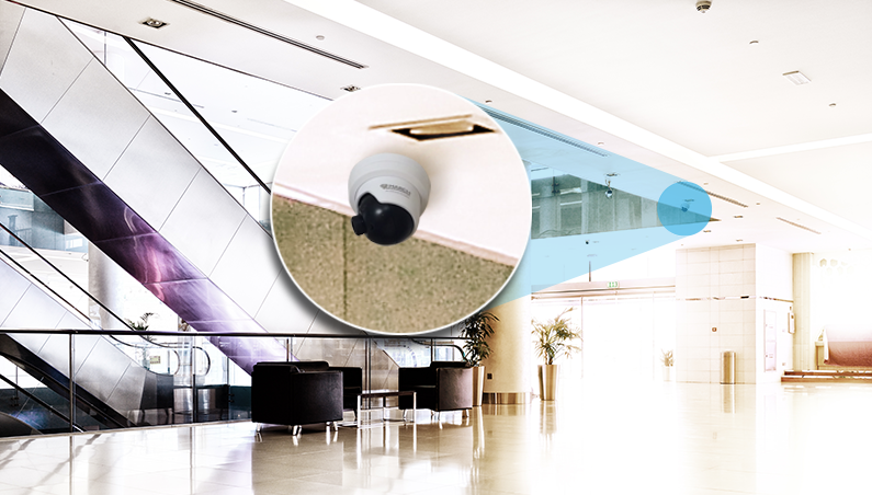 the March Networks ME4 Discreet IR Dome security camera is mounted in a commercial mall.