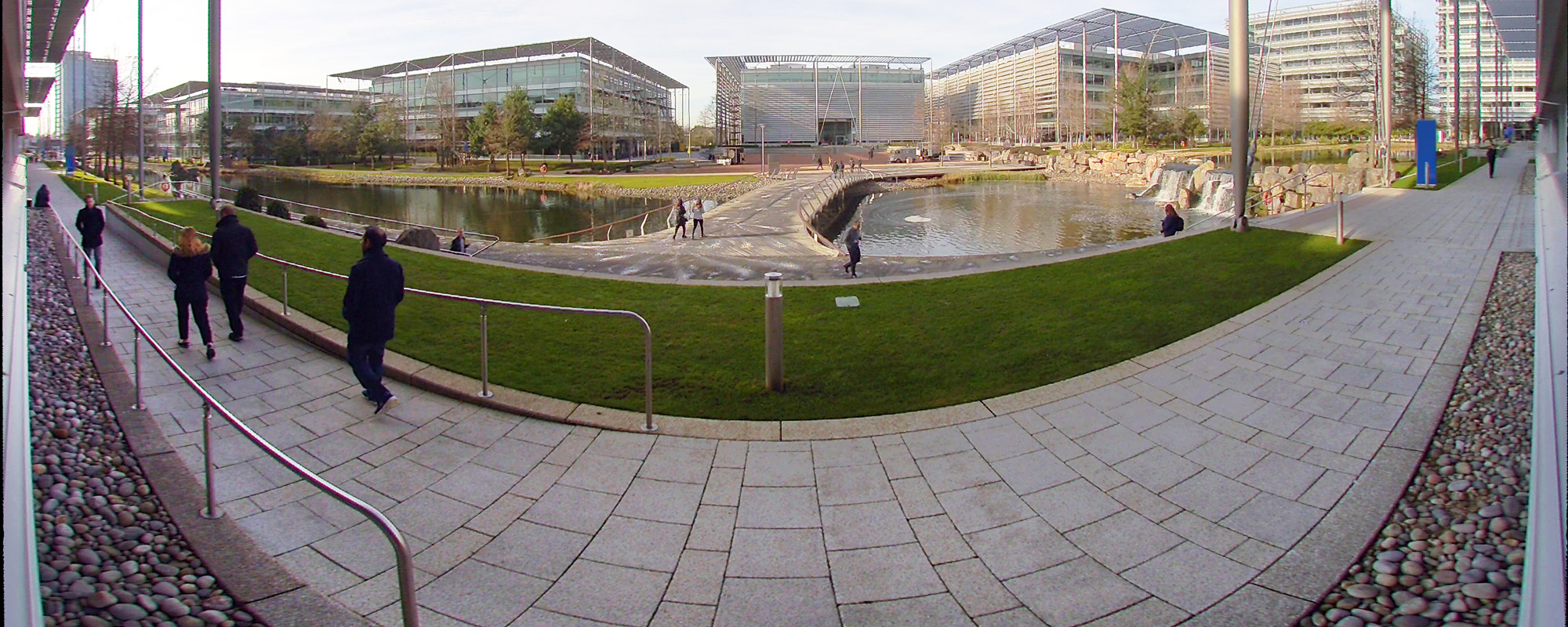 a panoramic video surveillance image of an outdoor walkway captured by the Evolution 180-degree outdoor camera.