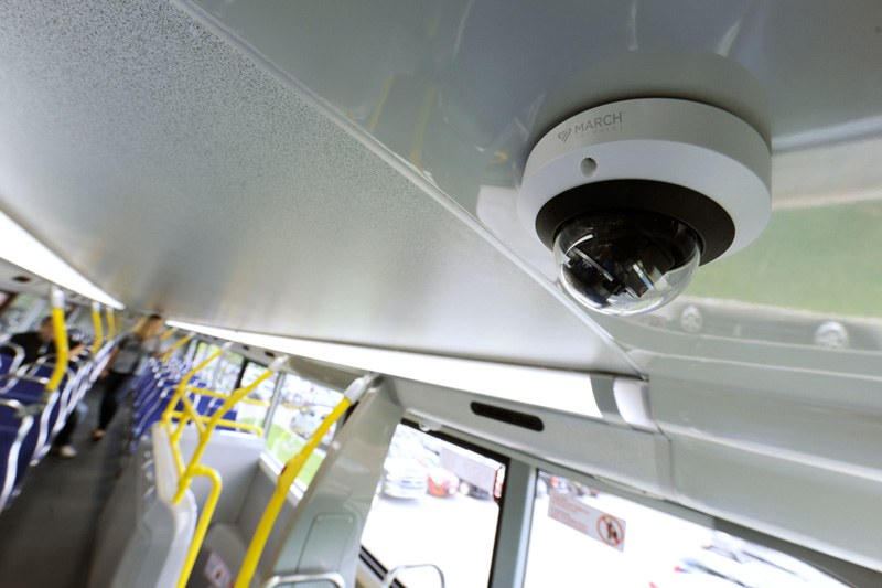 The March Networks ME4 IR MicDome security camera is mounted inside a bus.