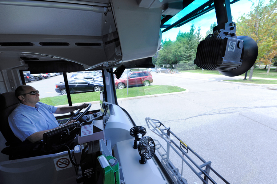 the Mobile HDR Forward Facing Camera is seen mounted on the inside of a bus, looking out the windshield
