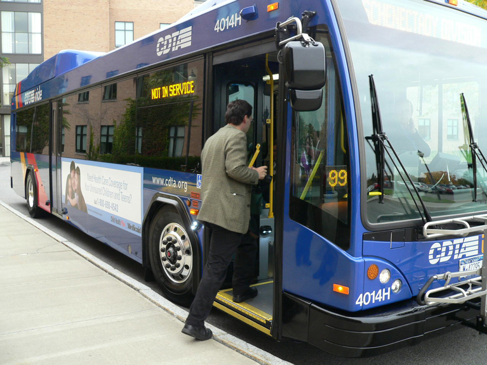 a man boards a Capital District Transportation Authority bus.
