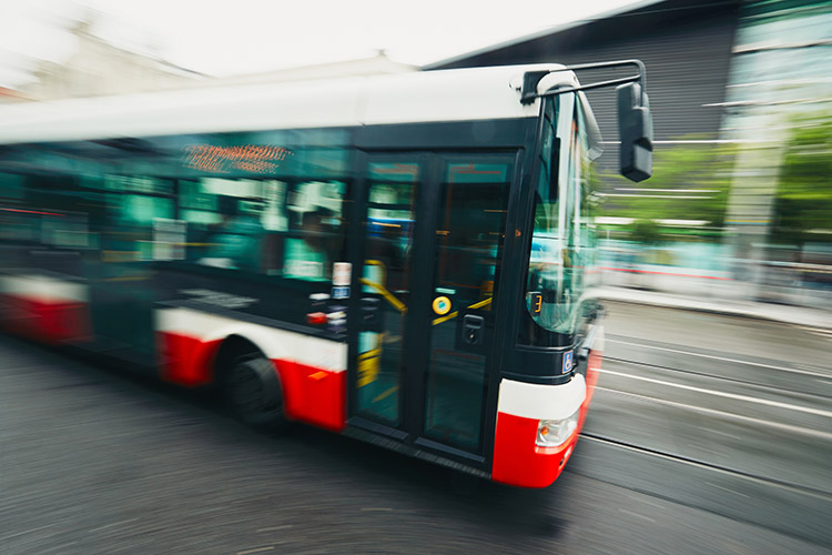 A photo of a bus driving down the street