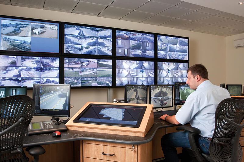 A video surveillance control room, with multiple monitors showing surveillance images.