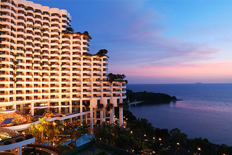 A large hotel overlooking the water