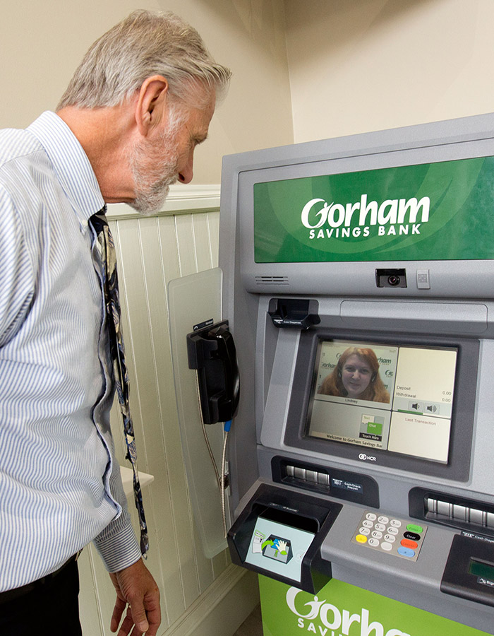 A man uses a Gorham Savings Bank Interactive Teller Machine