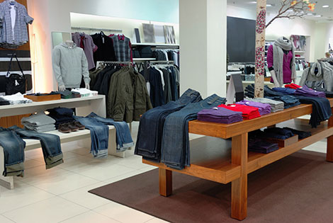 clothing is displayed in a retail clothing store