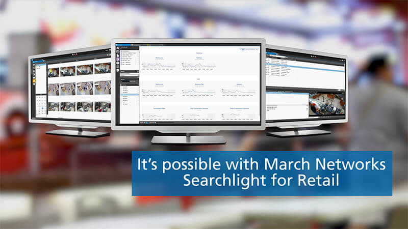 Three monitors display the March Networks Searchlight software user interface