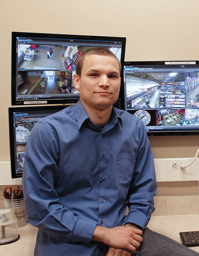 Colin Gubernick, senior investigator for Eickhoff's Supermarkets, sits in the company's video surveillance control room.