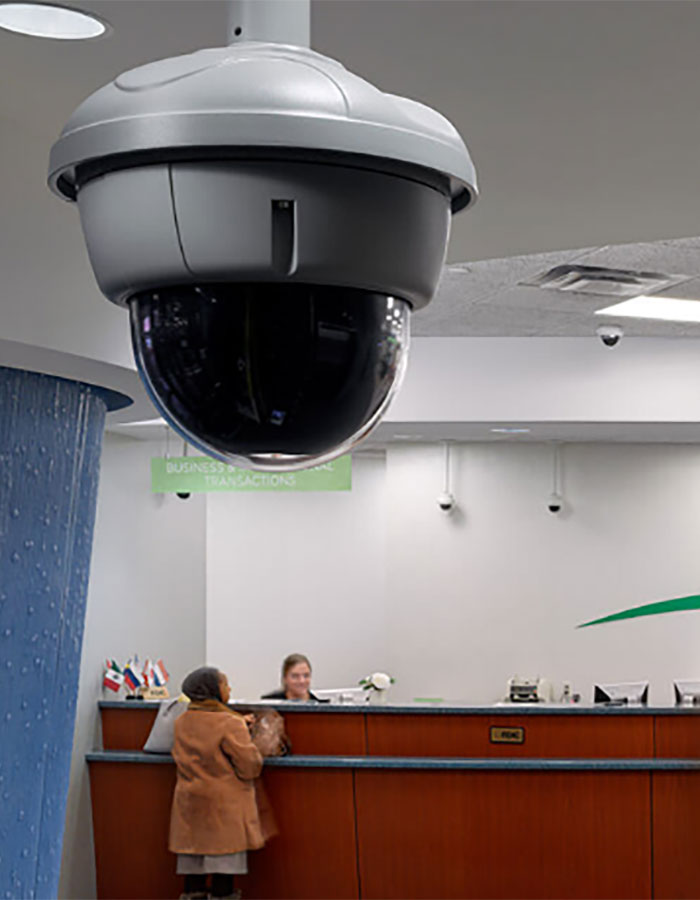 A March Networks camera on a ceiling in a bank