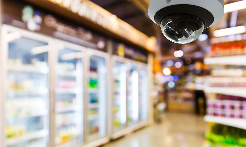 A security camera overlooks a convenience store