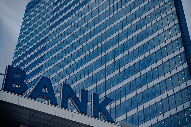 """An outdoor sign that reads """"Bank"""""""