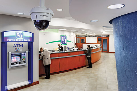 The inside of a bank with a visible security camera