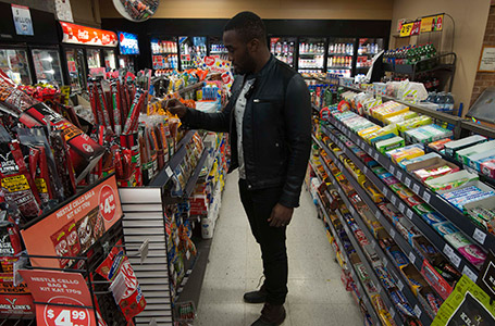 A man looks at items in a convenience store