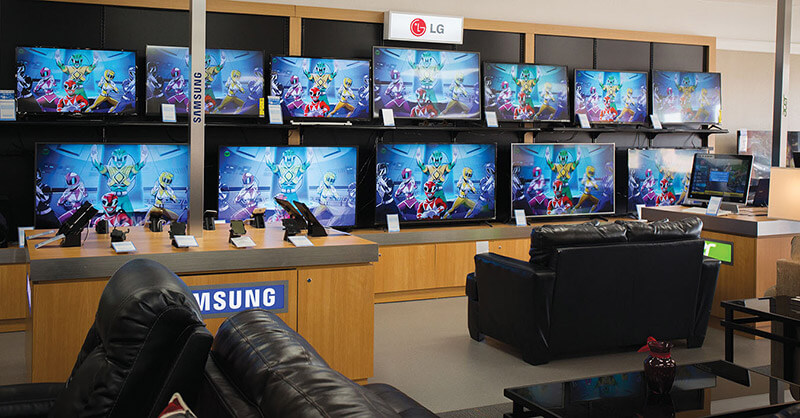 A wall of TVs is on display at Rent-A-Center