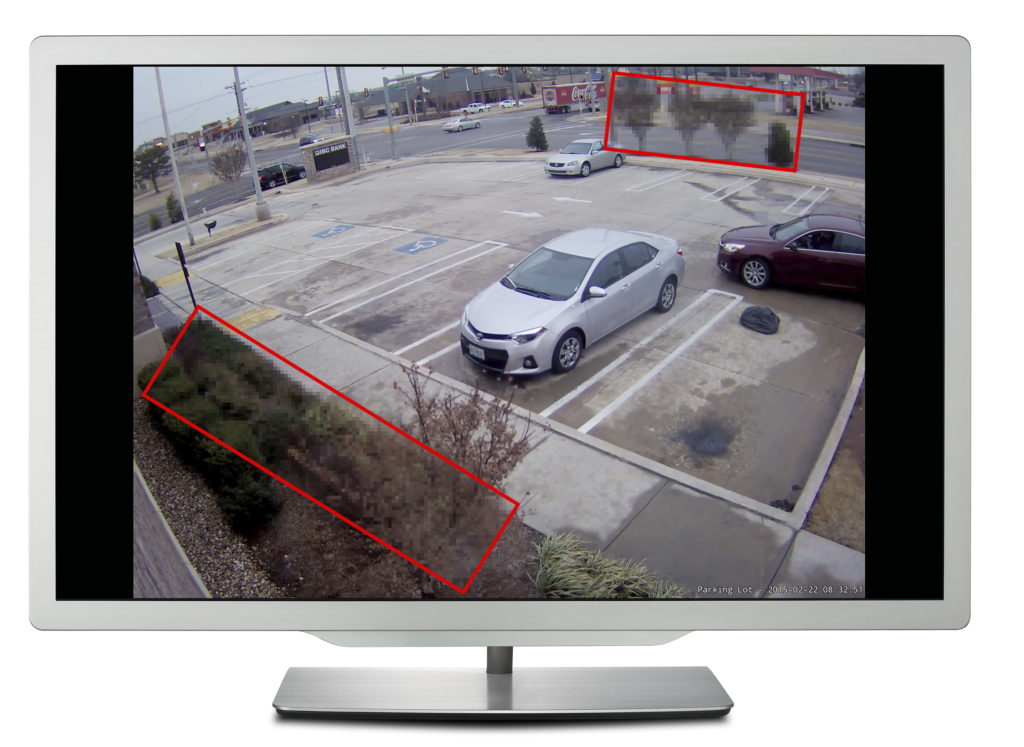 Computer monitor showing a parking lot with boxes drawn around the foliage to demonstrate Region of Interest compression being applied.