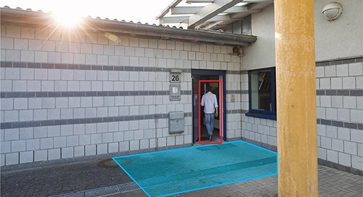 Man entering through a back doorway with detection of camera sensor