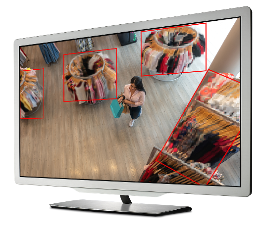 Computer monitor displaying woman shopping in a retail clothing store. Region if Interest compression is applied to the racks of clothing