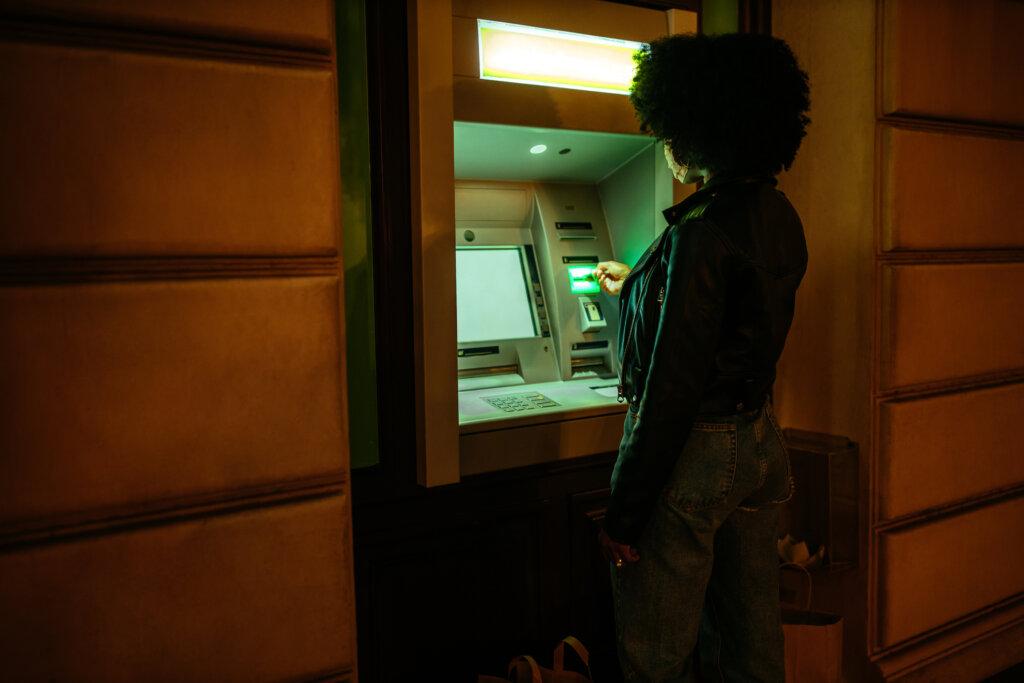 Customer using ATM at night